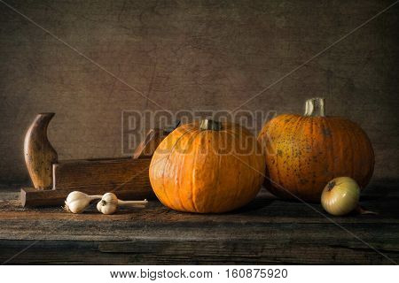 Nature morte with pumpkin, onion, garlic and plane