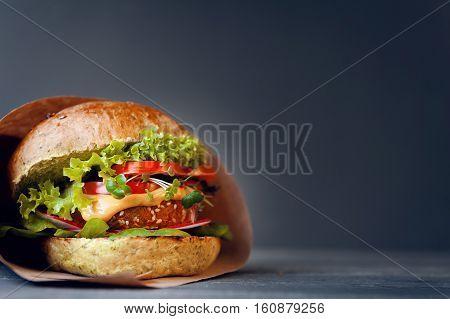 Veggie Burger On A Black Wooden Background