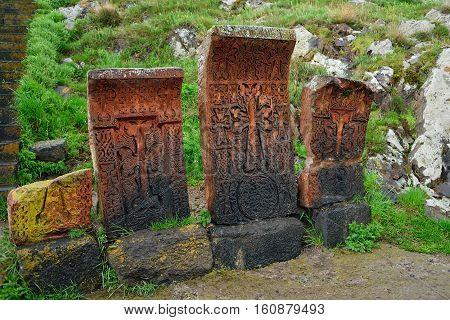Armenian khachkars. Unique tombstones of volcanic tuff. Armenian attraction.