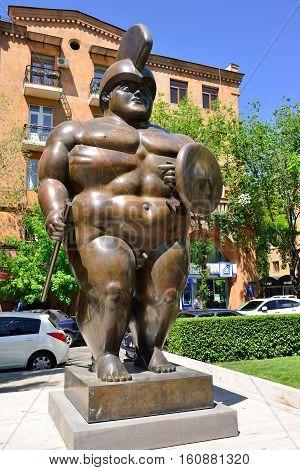 YEREVAN ARMENIA - MAY 2016: Modern art statue Roman Gladiator near the Yerevan Cascade a giant stairway in Yerevan Armenia.