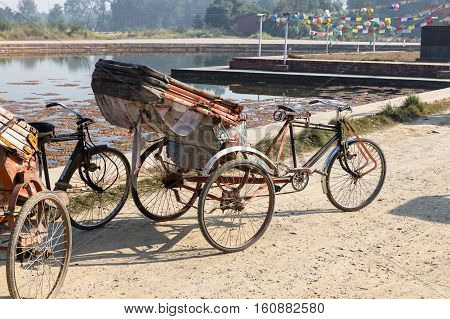 trishaw, parking place near the pond, Lumbini Nepal