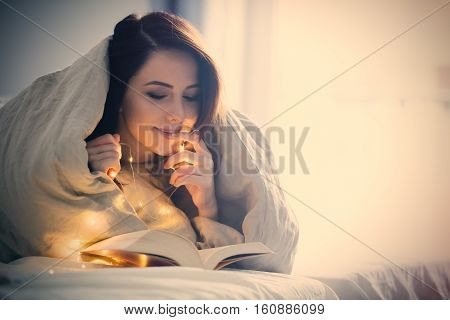 Woman With Fairy Lights And Book