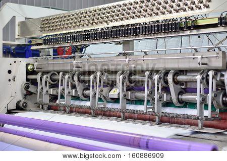 sewing equipment loom. Equipment at a garment factory