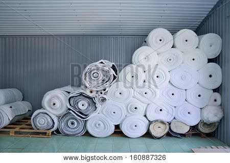 Sintepon. Insulation for clothing. Insulation material. The concept of sewing production. Warehouse tissues.