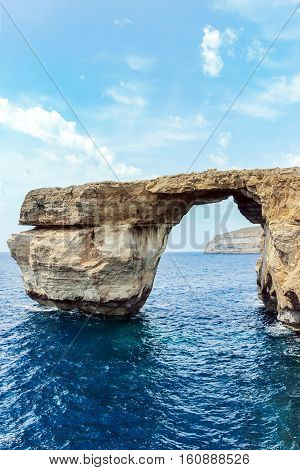 blue window with ocean in gozo malta