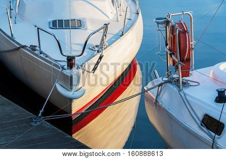Yachts berthed in yacht harbor close up