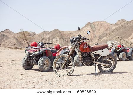 Egypt Sharm el sheikh - august 2016: The bike honda is parked in the desert without people