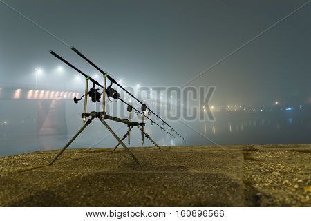 Carp Rods In Foggy Night. Urban Edition. Night Fishing