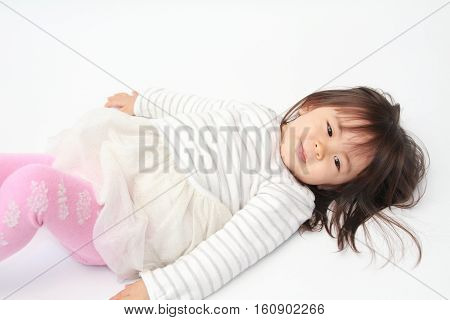 Lying down cute Japanese girl (2 years old)