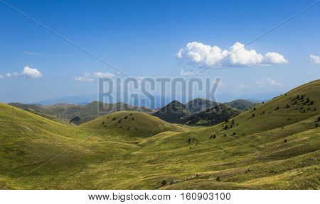 Panoramic view of beautiful landscape with Gran Sasso d'Italia peak at Campo Imperatore plateau in the Apennine Mountains, Abruzzo, Italy