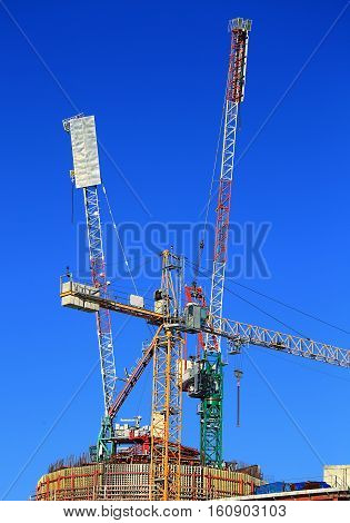 Cranes on the construction site of an industrial facility
