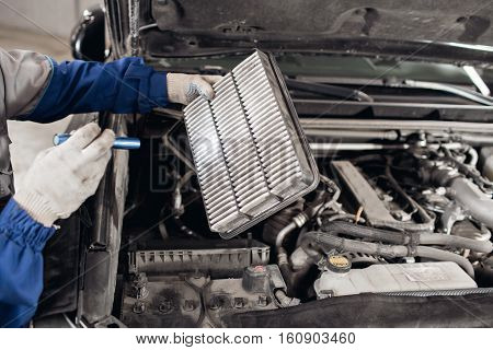 Car mechanic symptoms analysis part air filter of engine for maintaining car isolated on white background with clipping path