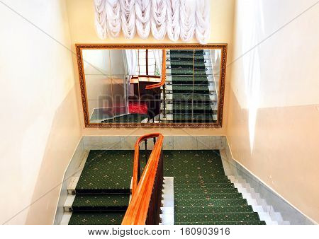 Large mirror in the the stairway of the spacious building