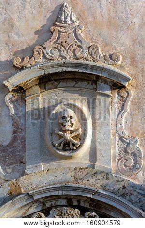 Skull And Crossbones On The Facade Of San Giuseppe In Taormina.