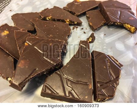 Pieces of dark gourmet chocolate from cocoa seeds one of the best antioxidant sources broken into pieces decadent dessert with room for copy