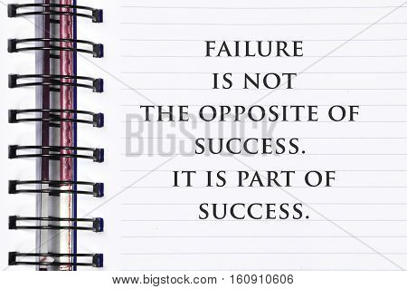 Inspirational Motivating Quote On Spring White Note Book. Failure Is Not The Opposite Of Success. It