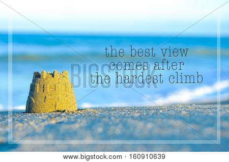 Inspirational Motivating Quote On Blur Beach View With Sand Castle