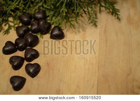 Dark Chocolate Hearts on a vintage rustic background for Christmas card or healthy eating background image with room for copy or message seasonal greetings