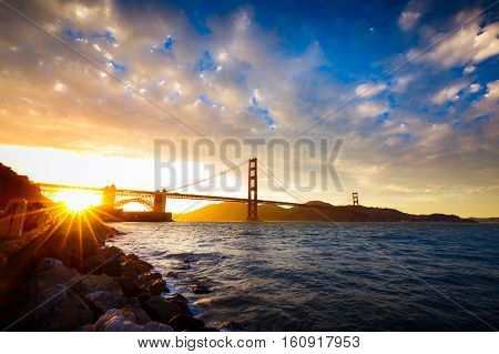 Sunset At The Golden Gate Bridge With Sun Starburst