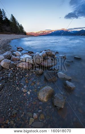 Large rocks on shore on Pend Oreille Lake in Idaho.
