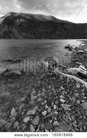 A black and white landscape image of Pend Oreille Lake in Idaho.