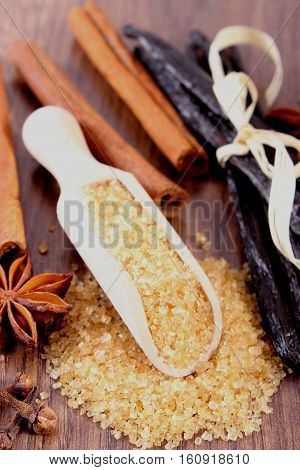 Sugar Cane, Fragrant Vanilla And Cinnamon Sticks On Wooden Surface Plank