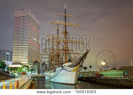 YOKOHAMA, JAPAN - NOVEMBER 6, 2016 : Nippon Maru sailing ship in Yokohama at night, Japan. Nippon Maru was built in 1930 as a training ship for the cadets of Japanese merchant marine.