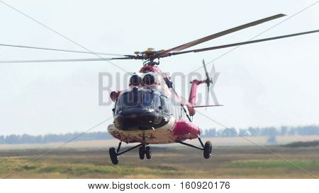 Modern emergency medicine helicopter take off at airfield, telephoto