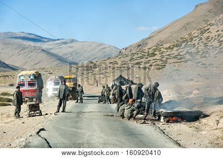 LADAKH, INDIA - SEPTEMBER 7, 2006: men at work along Leh-Manali Highway, one of the highest paved road in the world at 5,328 metres (17,480 ft).  Ladakh, India.
