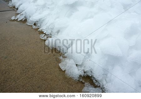 close up on snow and ice removed from street