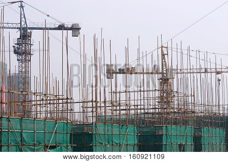 construction site with cranes and construction frame