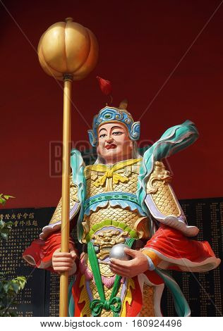 God Statue At The Main Gate Of Chinese Temple