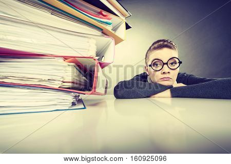 Accountant Terrified Of Pils Of Binders.