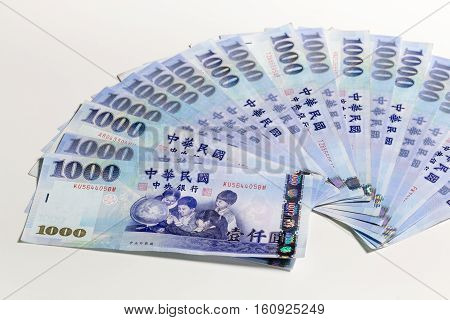 New Taiwan Dollars Fanned Out On White Background