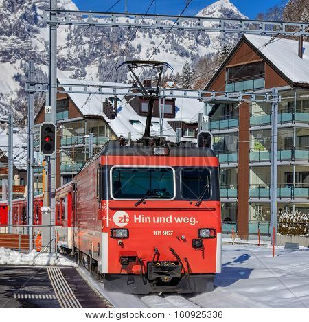 Engelberg, Switzerland - 9 March, 2016: a train heading to the city of Lucerne leaving the Engelberg railway station, shallow depth of field picture. Engelberg is a resort town and municipality in the Swiss Canton of Obwalden.