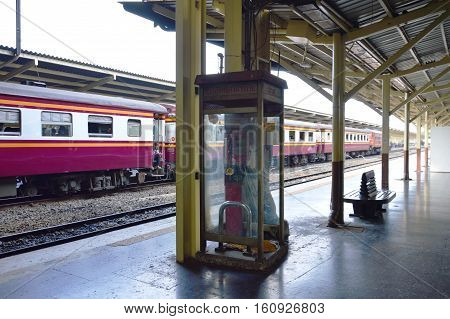 Bangkok Thailand December 2, 2016 : old phone booth no ones used anymore waiting for move and demolition on platform in Hua Lamphong oldest Bangkok railway station