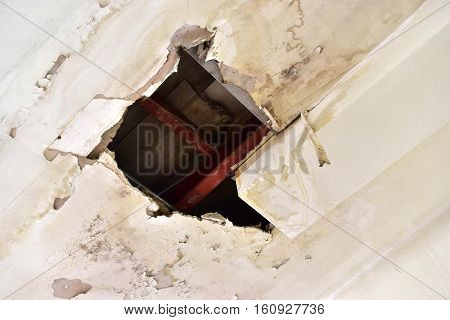 Rain water leaks on the ceiling causing damage tiles and gypsum board.