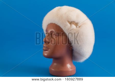pearly beret from natural mink on a mannequin
