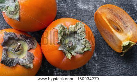 Healthy juicy ripe sliced persimmons fruit. Top view.