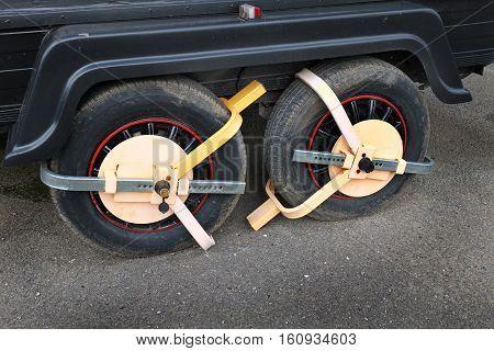Wheels on sales trailer locked to prevent being stolen.