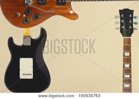 Exotic wood electric guitar back of guitar body and neck on the light skin background with plenty of copy space.
