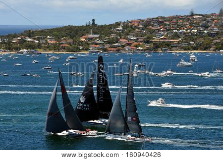 Sydney Australia - December 26 2013. Top three yachts after the start: Wild Oats Perpetual 8 Ragamuffin. Sydney to Hobart Yacht Race on Boxing day.