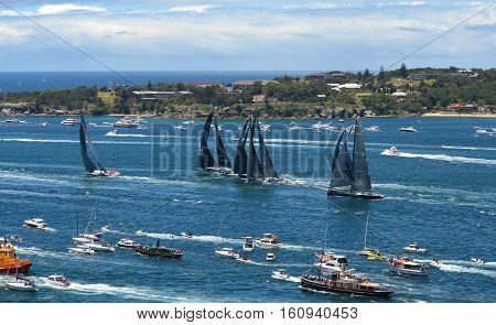 Sydney Australia - December 26 2013. Wild Oats leading after the start. The Sydney to Hobart Yacht Race is an annual event starting in Sydney on Boxing Day and finishing in Hobart.