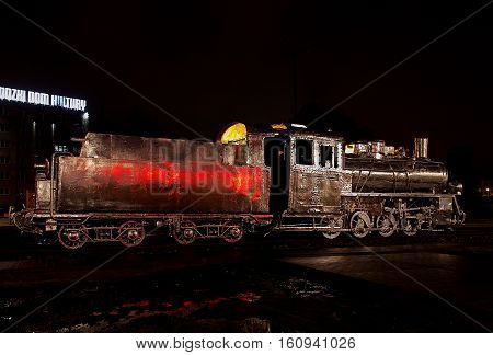 Steam locomotive from the past. Lodz, Poland - December 10, 2016 Decorated with historic steam locomotive exhibited in Lodz with the opening of a modern railway station Lodz Fabryczna.
