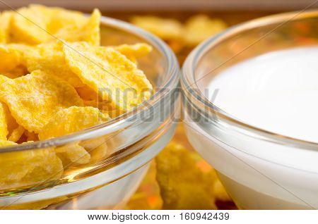 Transparent Cup With Milk And Corn Flakes Close-up