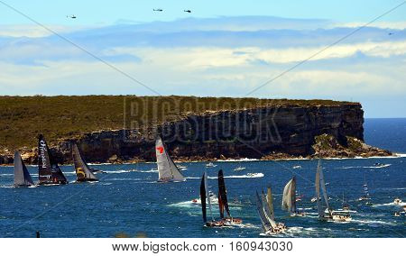 Sydney Australia - December 26 2013. Participiant Yachts approaching North Head. The Sydney to Hobart Yacht Race is an annual event starting in Sydney on Boxing Day and finishing in Hobart.
