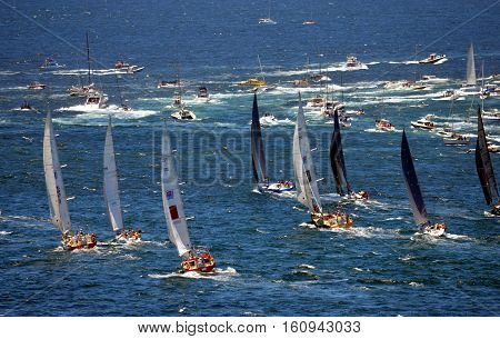 Sydney Australia - December 26 2013. Participiant Yachts approaching South Head. The Sydney to Hobart Yacht Race is an annual event starting in Sydney on Boxing Day and finishing in Hobart.