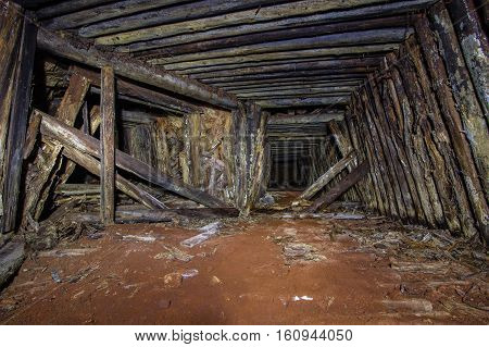 Abandoned old mine shaft tunnel wooden barring