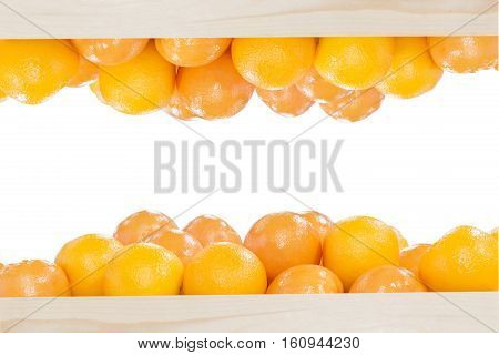The pile of oranges in the wooden box in upside and downside scene with the white background