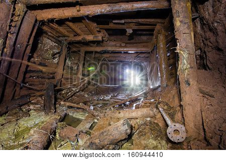 Abandoned old mine shaft tunnel wooden barring light